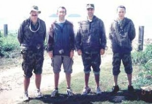 Figure 8: Collaborative investigation with mosquito repellents at Cowley Beach Training Area, Queensland, April 2001. (L to R) Major S. P. Frances (AMI), Dr N. Beebe (UTS)  Major  M.  Debboun  (WRAIR, USA), Senior  Colonel N.V. Dung (VADMP, Vietnam) preparing to test repellent effectiveness on themselves.